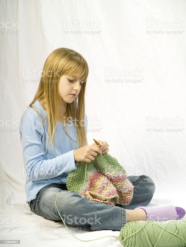 Young girl knitting royalty-free stock photo