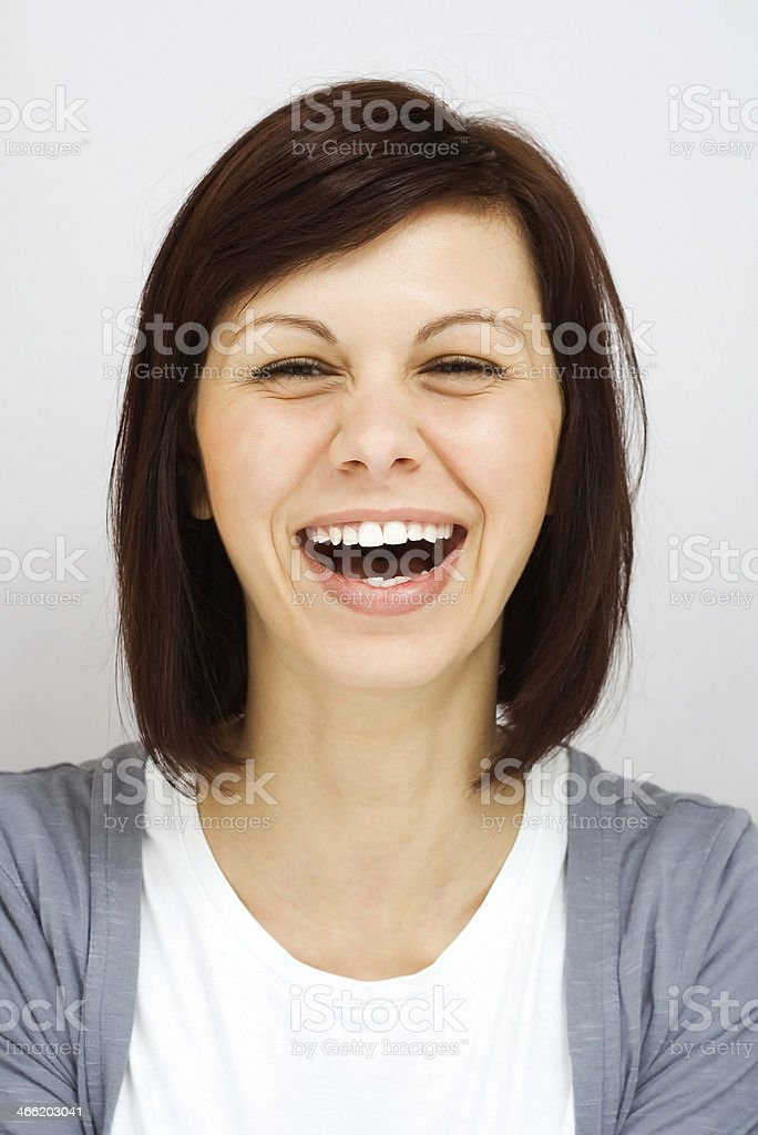 Young girl laughing sincerely stock photo