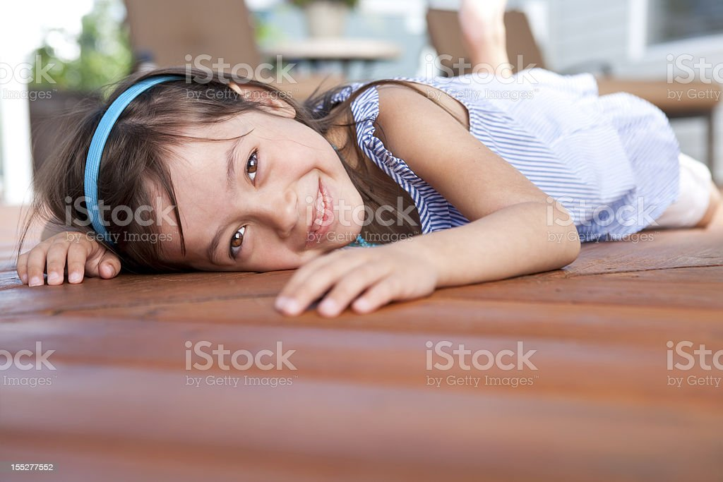 Young girl laying on deck royalty-free stock photo