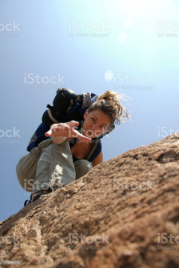 Young girl lending a hand while she is hiking royalty-free stock photo