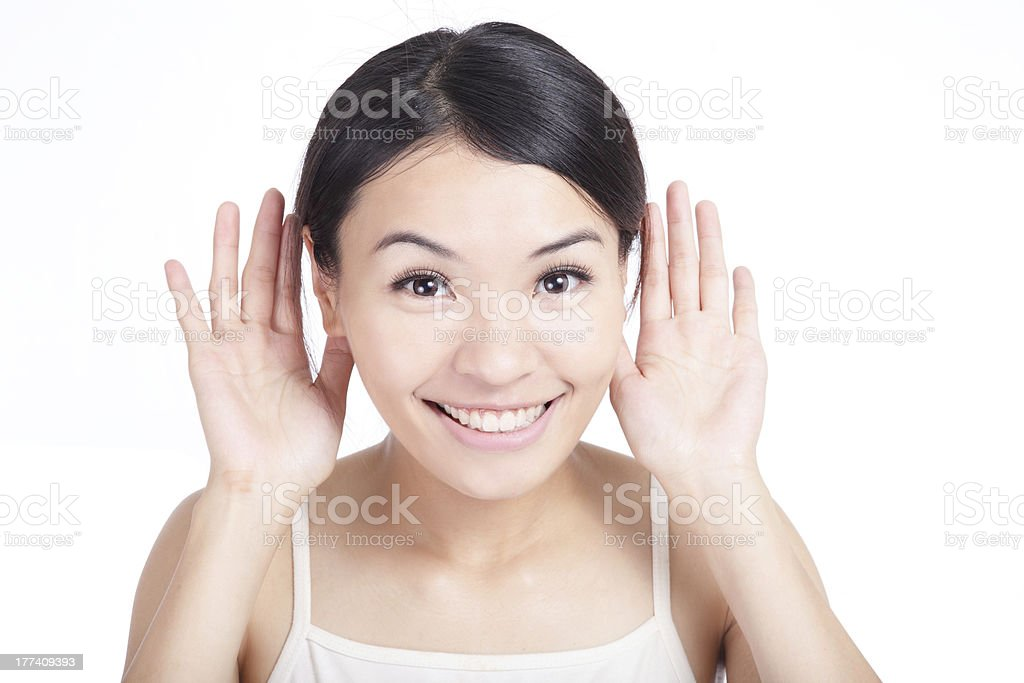 Young Girl listen by ear with smile stock photo