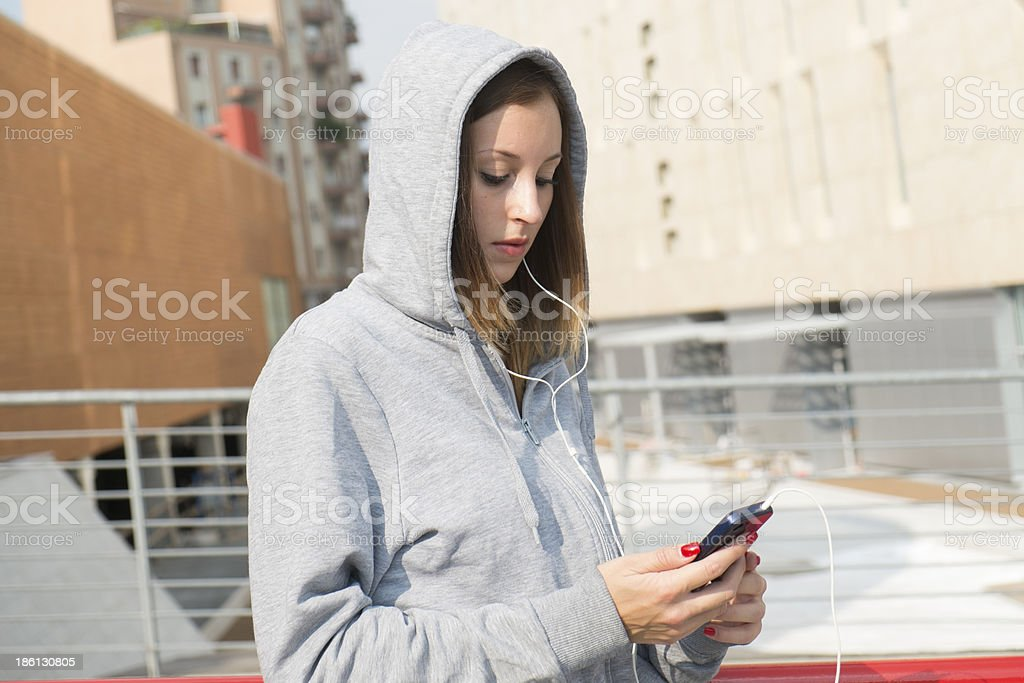 Young girl listening music with player royalty-free stock photo