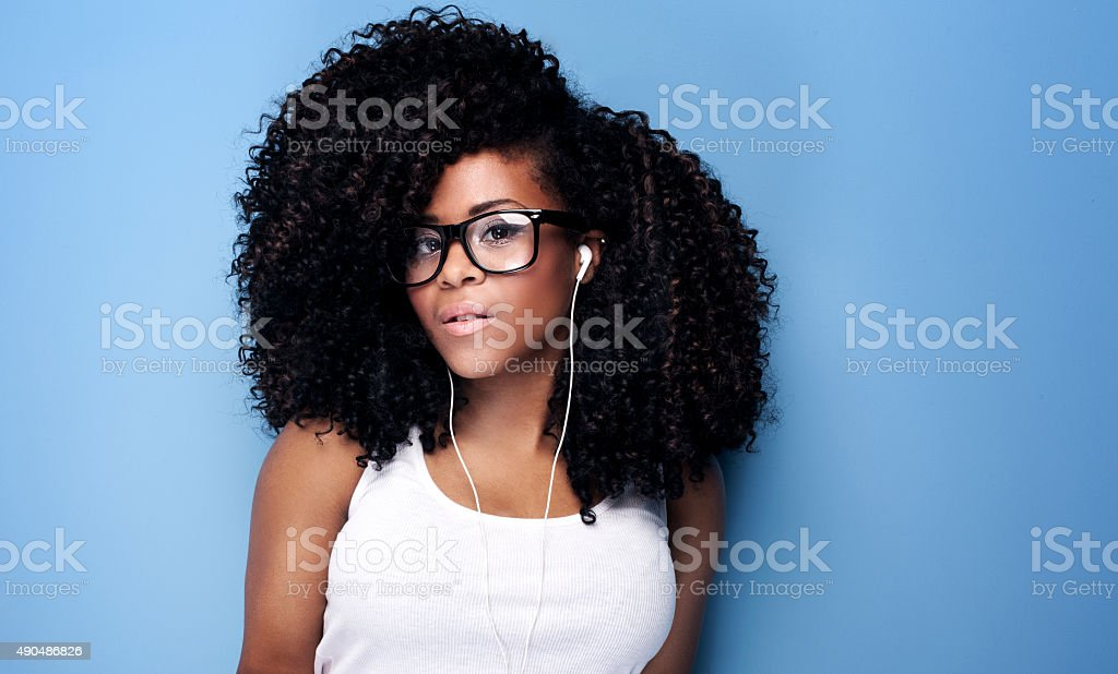 Young girl listening to music. stock photo
