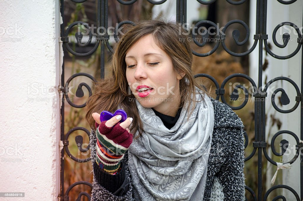 Young girl looking at a heart shaped mirror royalty-free stock photo
