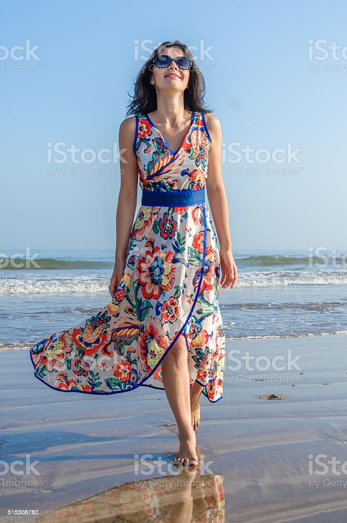 Young girl looking at the ocean and city stock photo