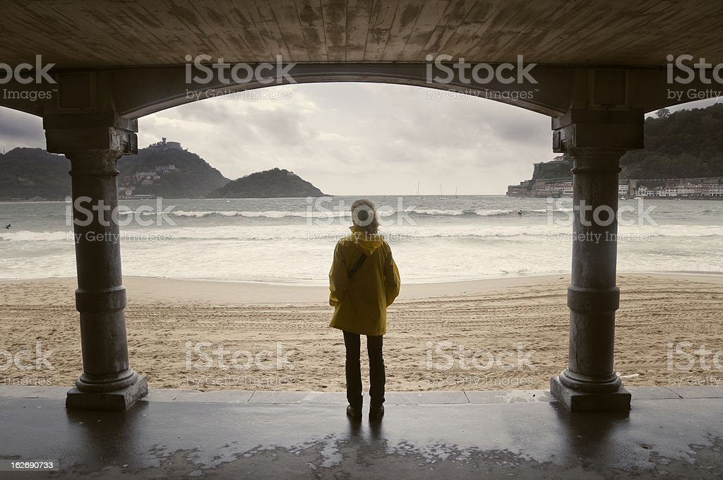 Young girl looking at the sea stock photo