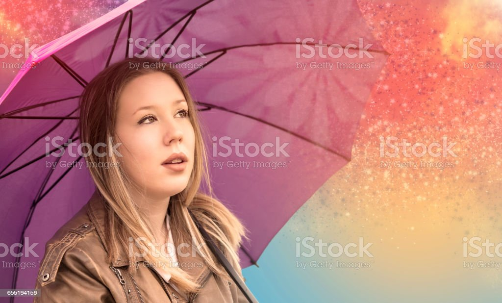 Young girl looking at the sky stock photo
