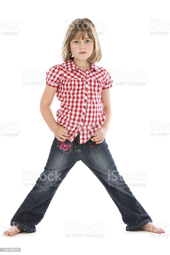 Young girl looking moody with hands on hips stock photo