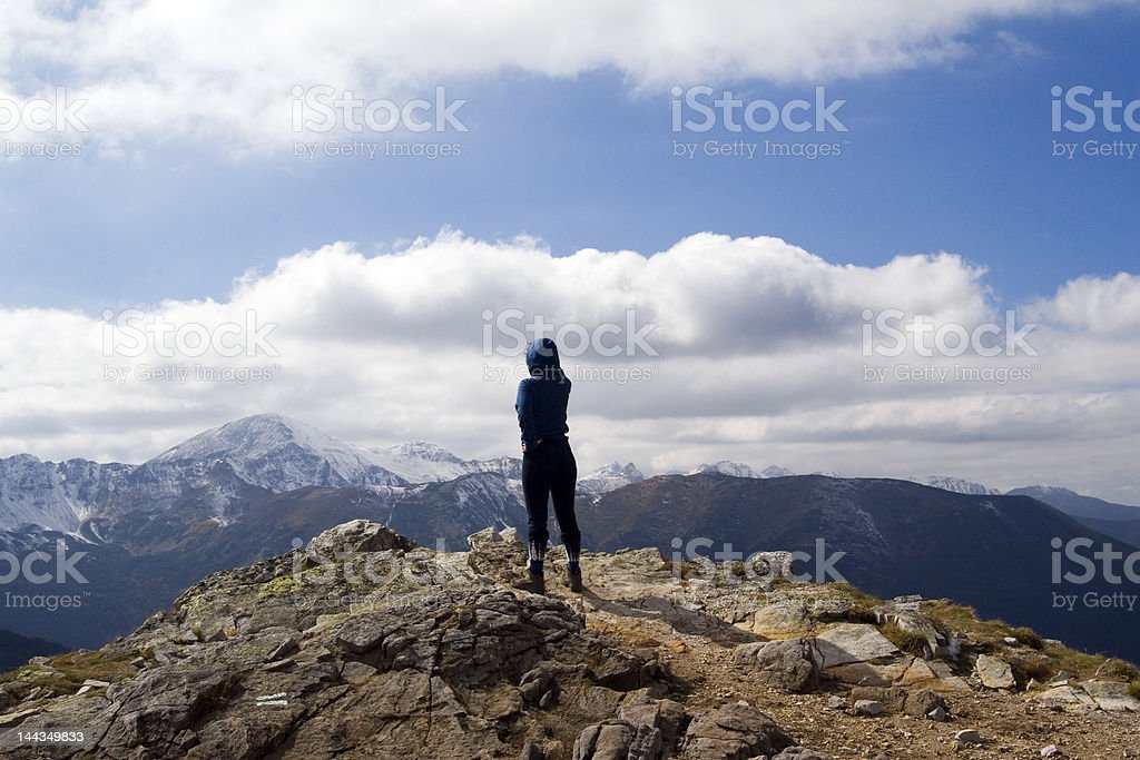 Young girl looking over high mountains royalty-free stock photo