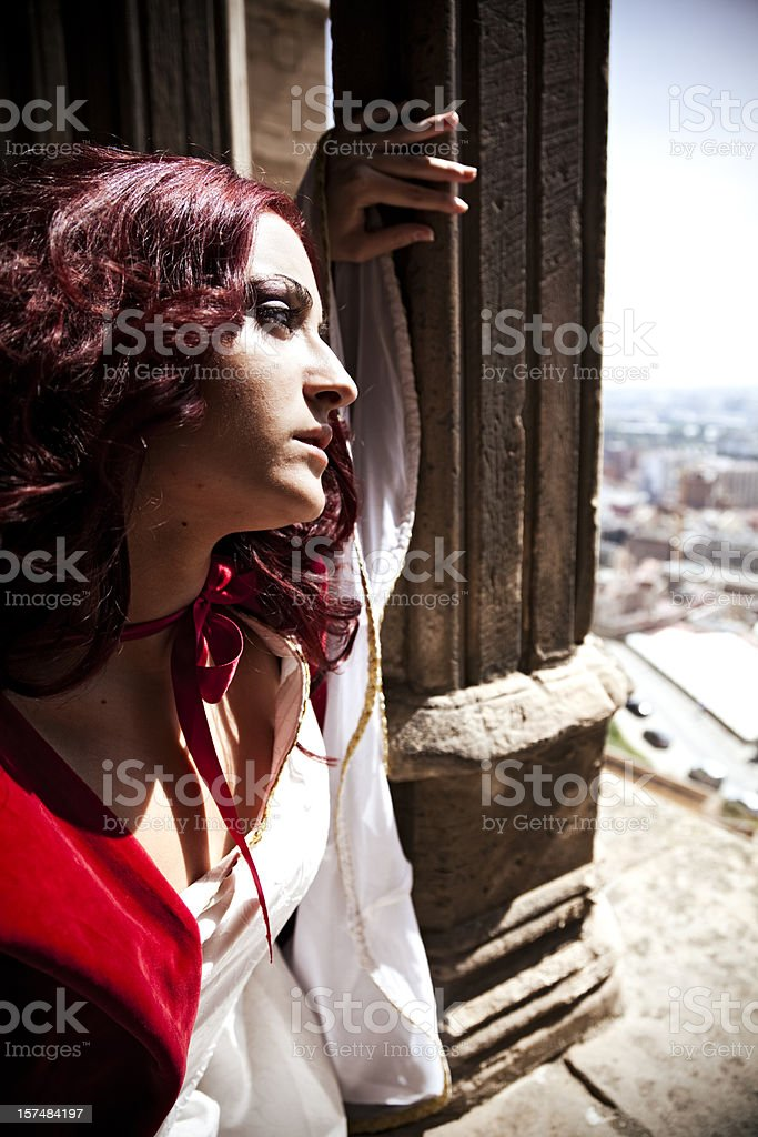 Young Girl looking over the city stock photo