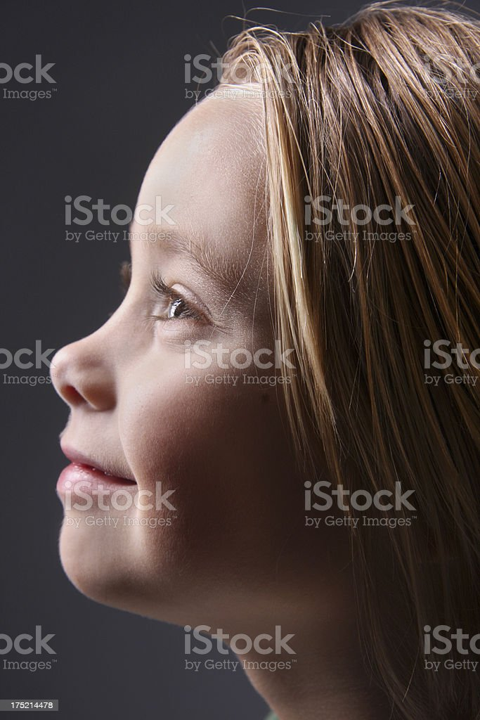 Young girl looking up to future royalty-free stock photo
