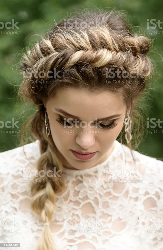 Young girl looks down stock photo
