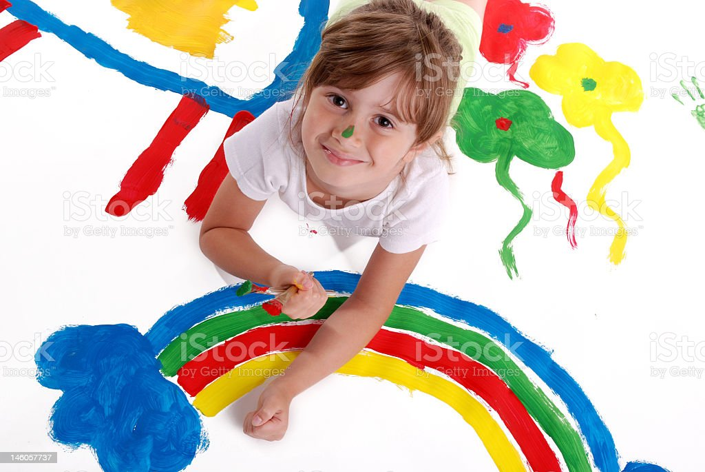 Young girl lying down and painting royalty-free stock photo