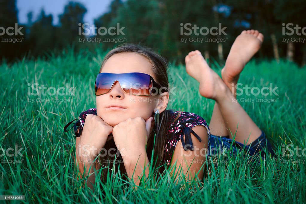 Young girl lying in grass royalty-free stock photo