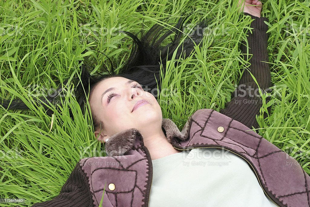 young girl lying in tall grass royalty-free stock photo