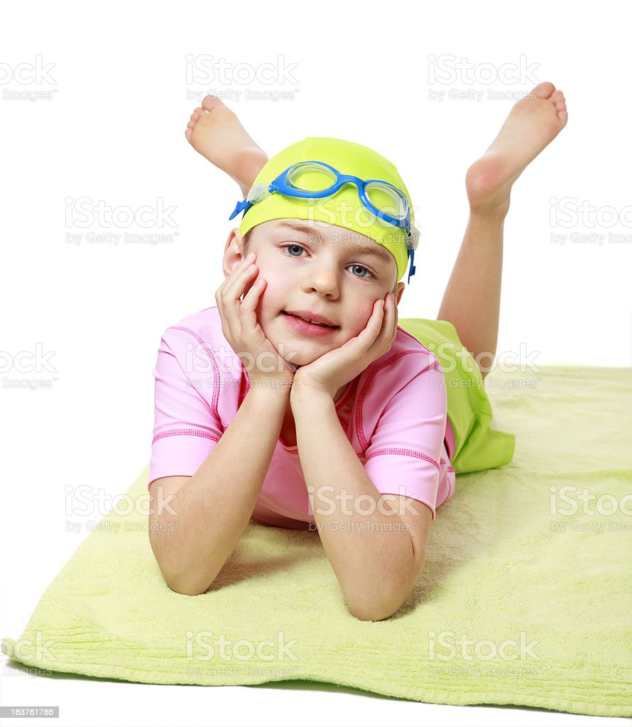 Young girl lying on bath towel stock photo