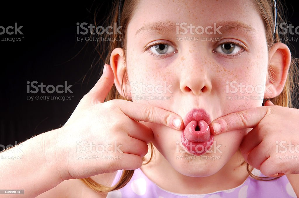 Young girl making a silly face stock photo