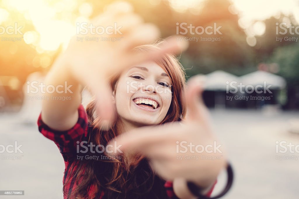 Young girl making finger frame stock photo