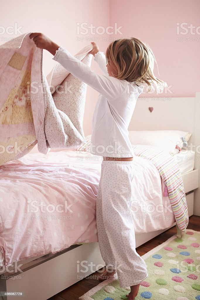 Young Girl Making Her Bed stock photo