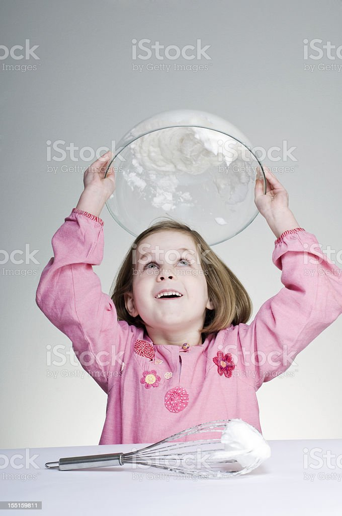 Young Girl Making Meringues stock photo