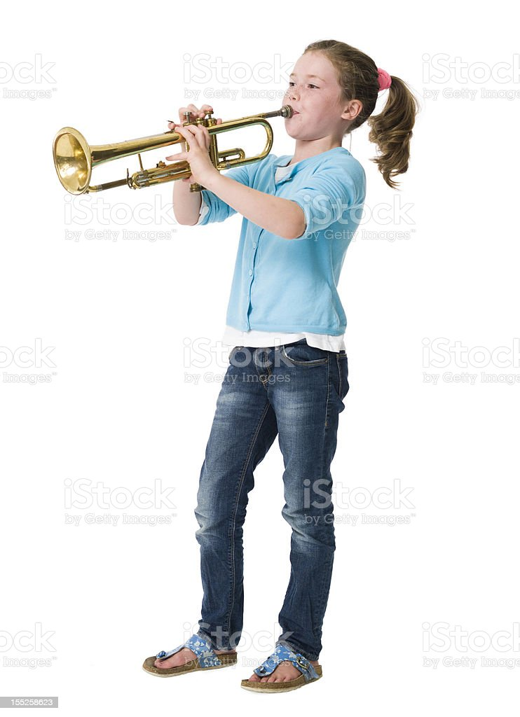 Young girl making music on trumpet against white background royalty-free stock photo