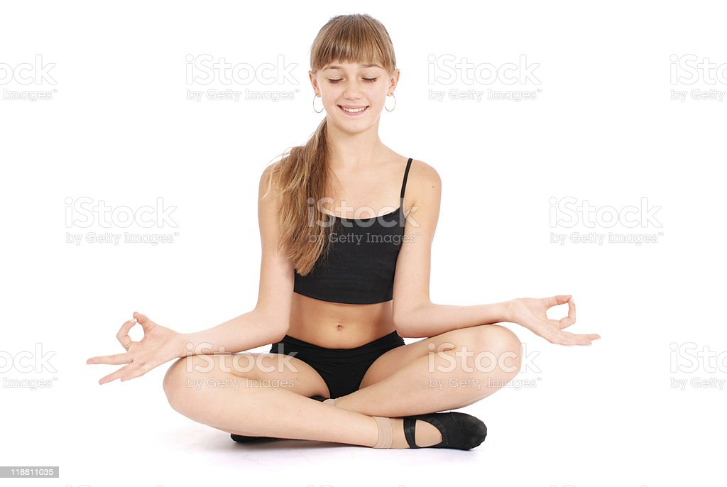 Young girl making yoga exercises stock photo