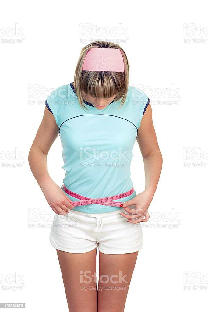 young girl measuring her belly royalty-free stock photo