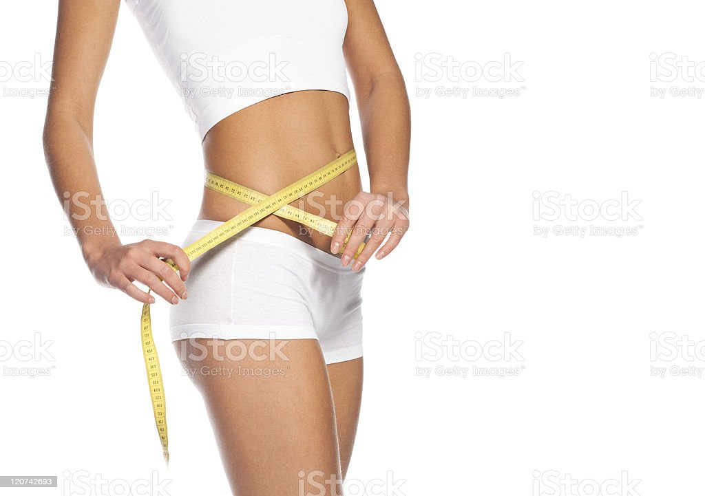 young girl measuring perfect shape of beautiful hips stock photo