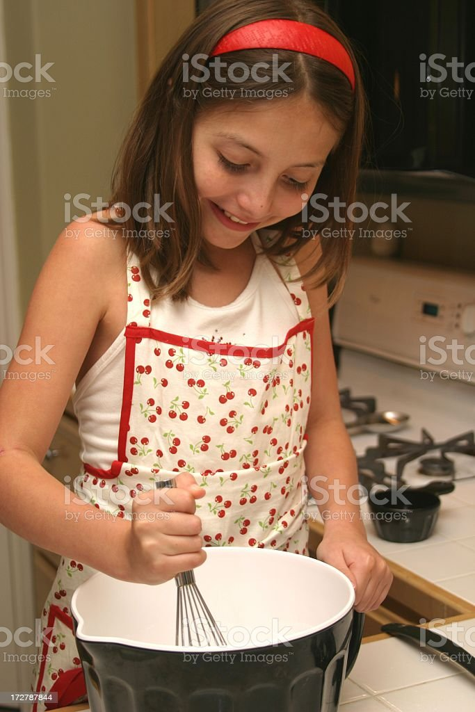 Young Girl Mixes Ingredients royalty-free stock photo