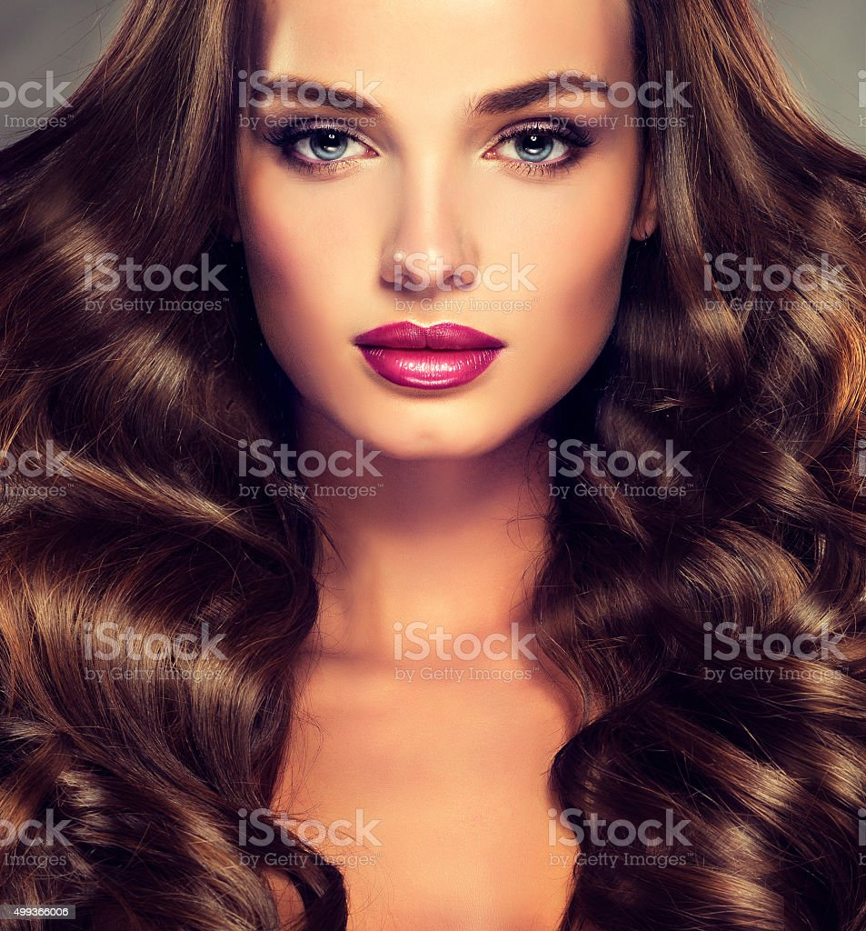 Young girl model with dense, curly hair stock photo