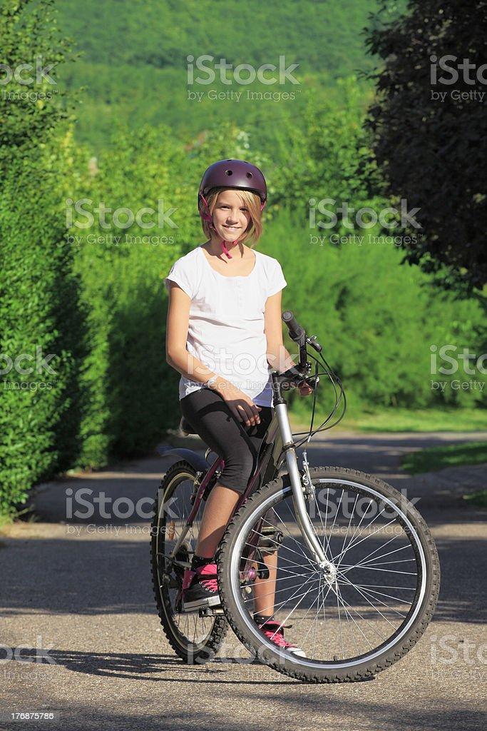 Young girl mountain biking royalty-free stock photo
