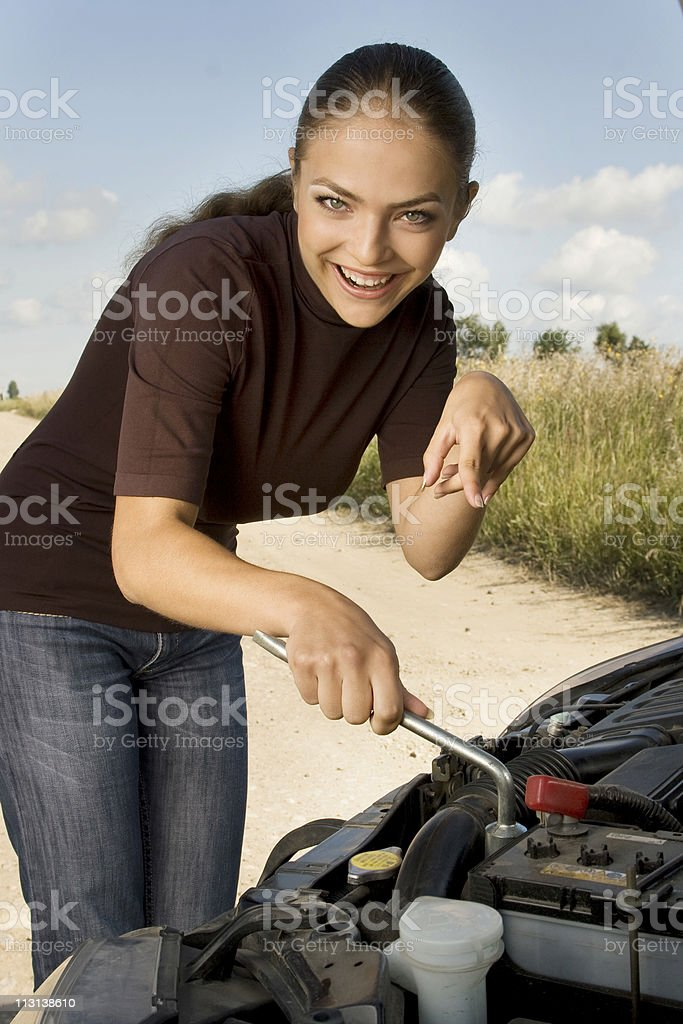 Young girl - novice at auto mechanic royalty-free stock photo