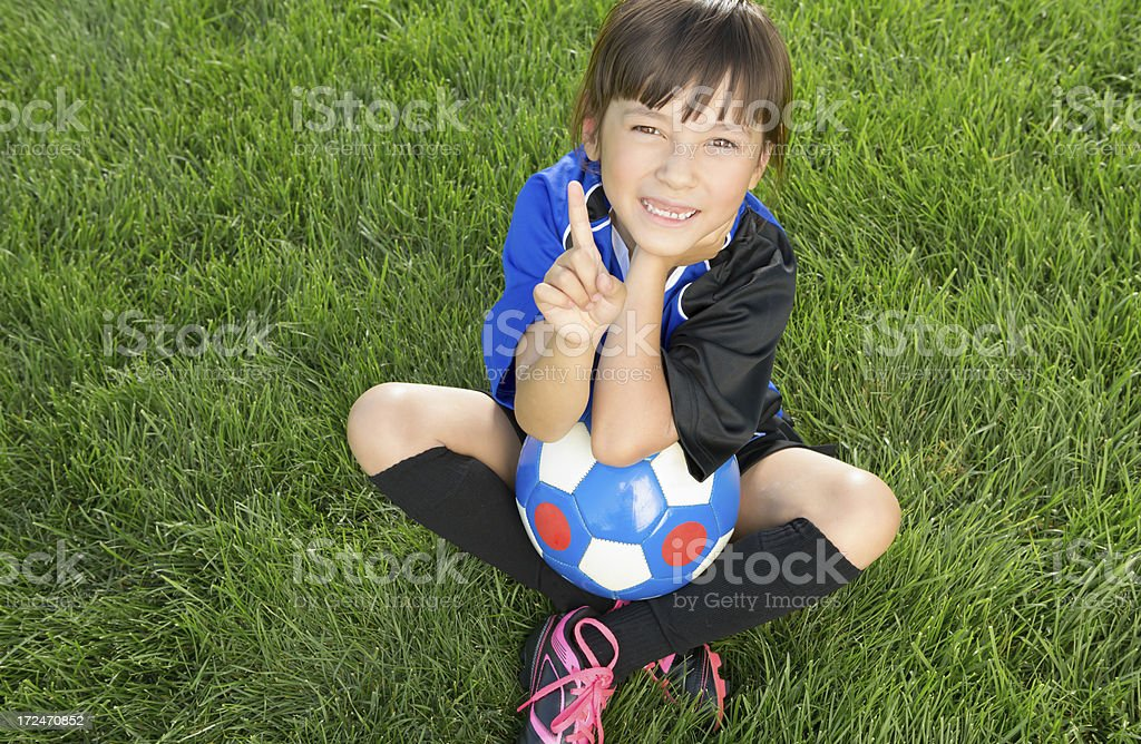 Young girl number one in soccer royalty-free stock photo