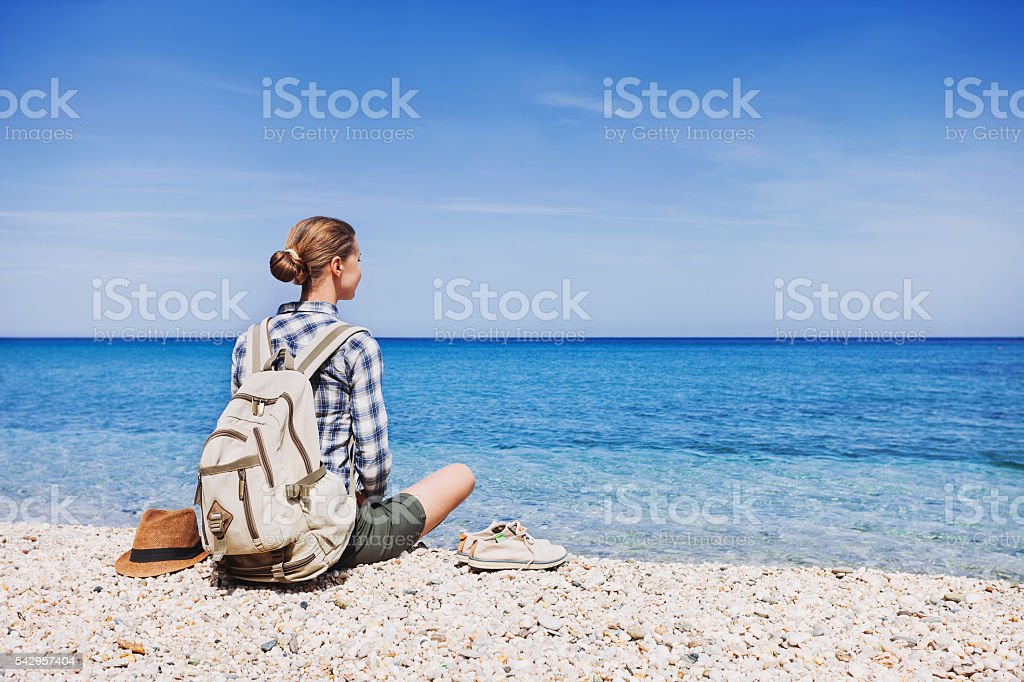 Young girl on a beach, travel concept stock photo