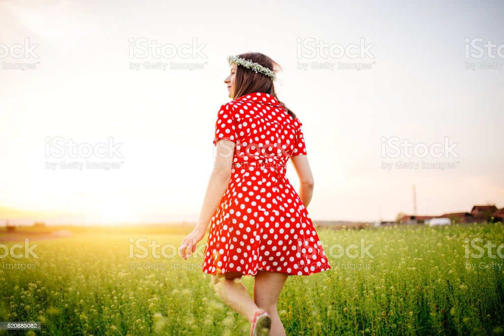 Young girl on a green field stock photo
