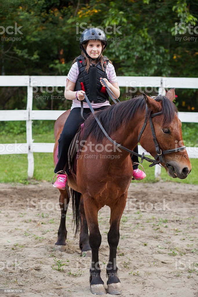 young girl on a horse stock photo