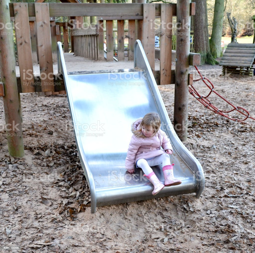 Young girl on a slide stock photo