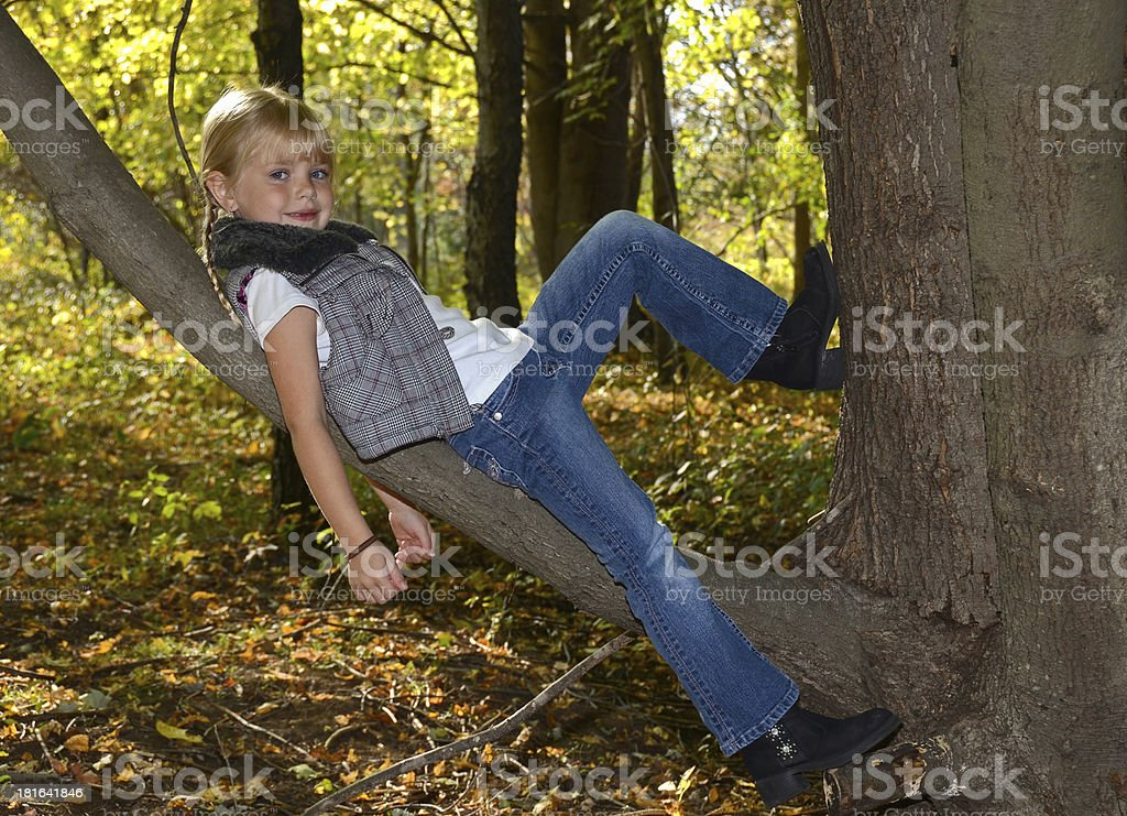 young girl on a tree branch royalty-free stock photo
