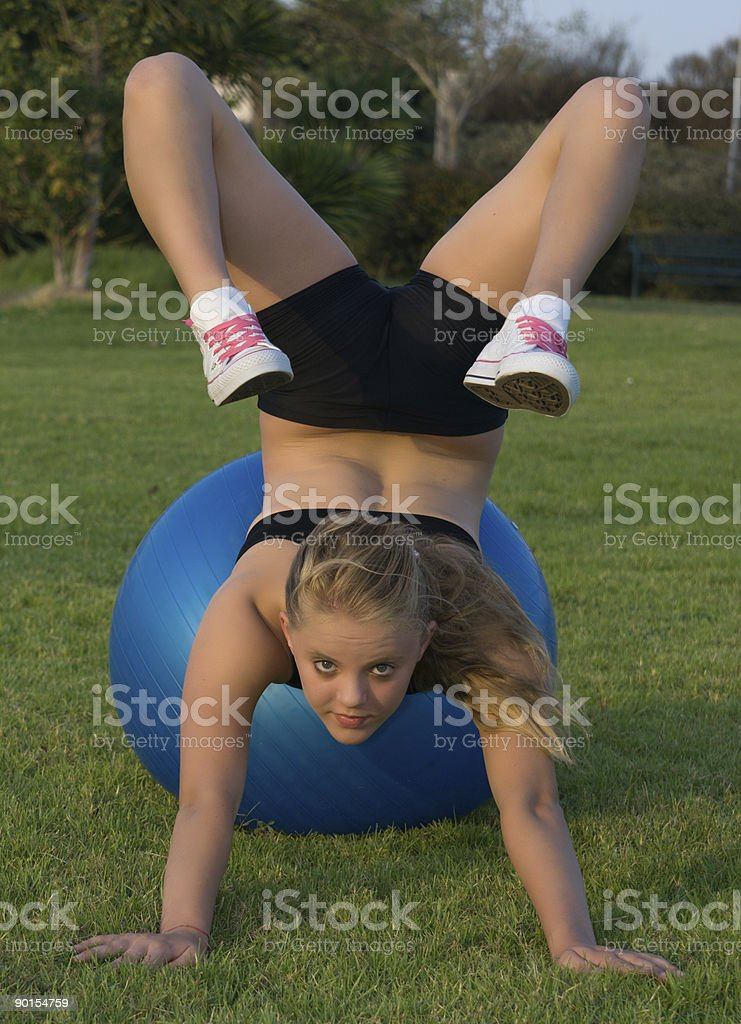 Young girl on blue fitness ball royalty-free stock photo