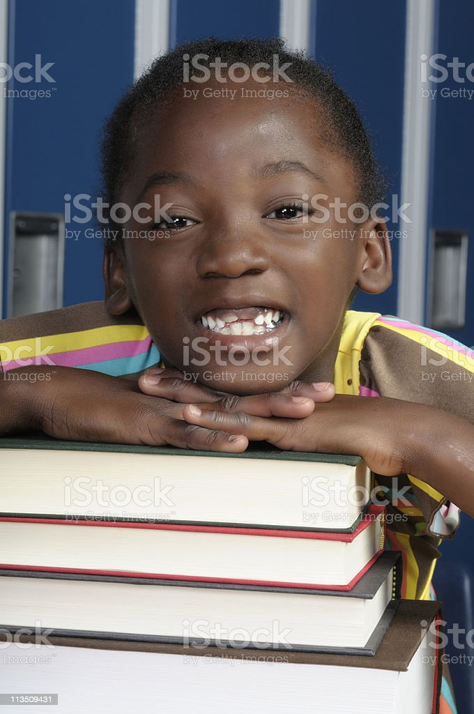 Young Girl on Books royalty-free stock photo