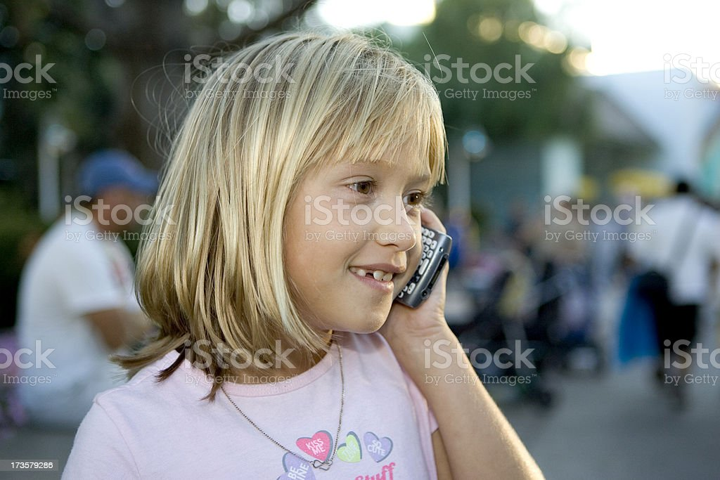 young girl on cell phone royalty-free stock photo