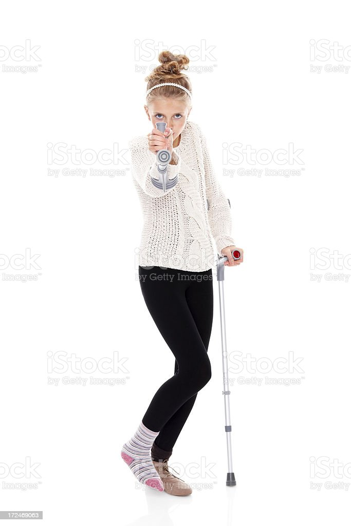 Young girl on crutches smiling over white royalty-free stock photo