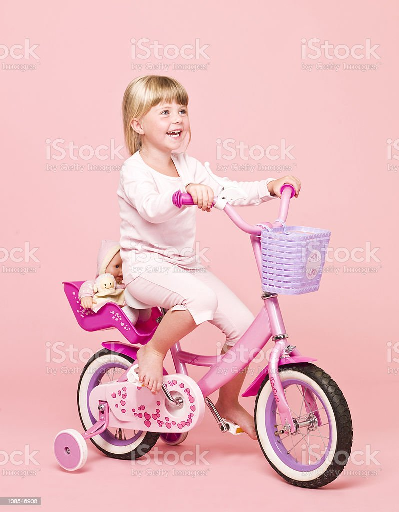 Young girl on her bike royalty-free stock photo