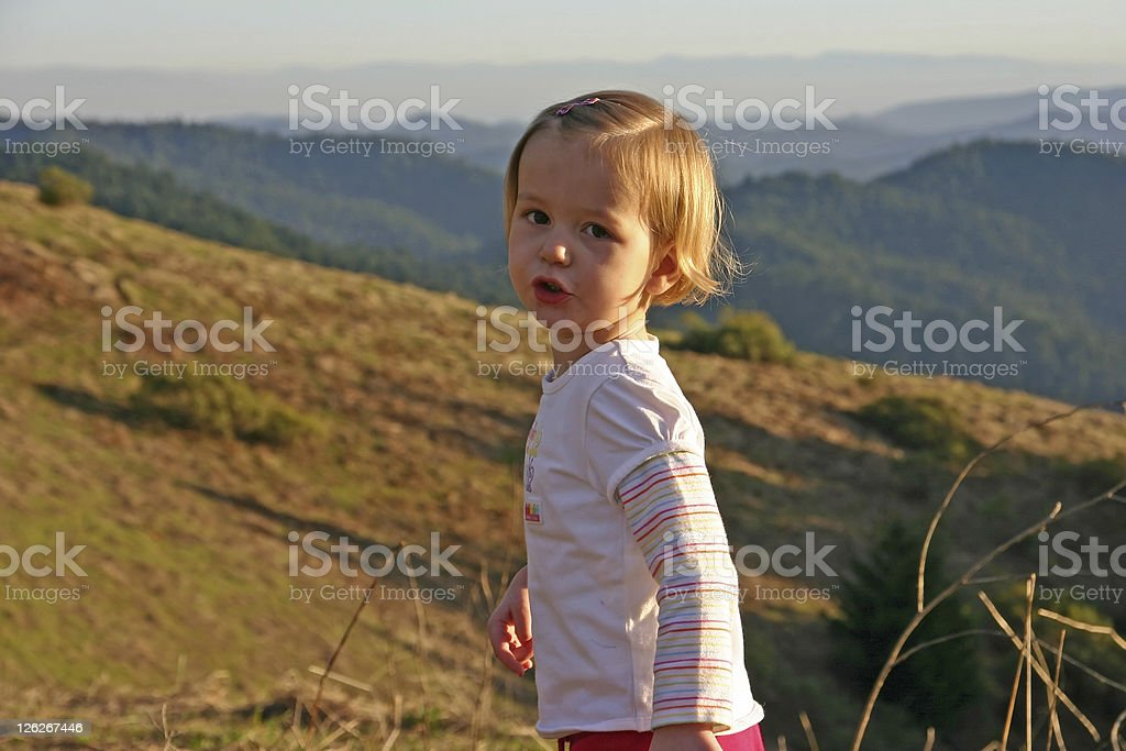 Young girl on hike through the mountains in California (USA) stock photo