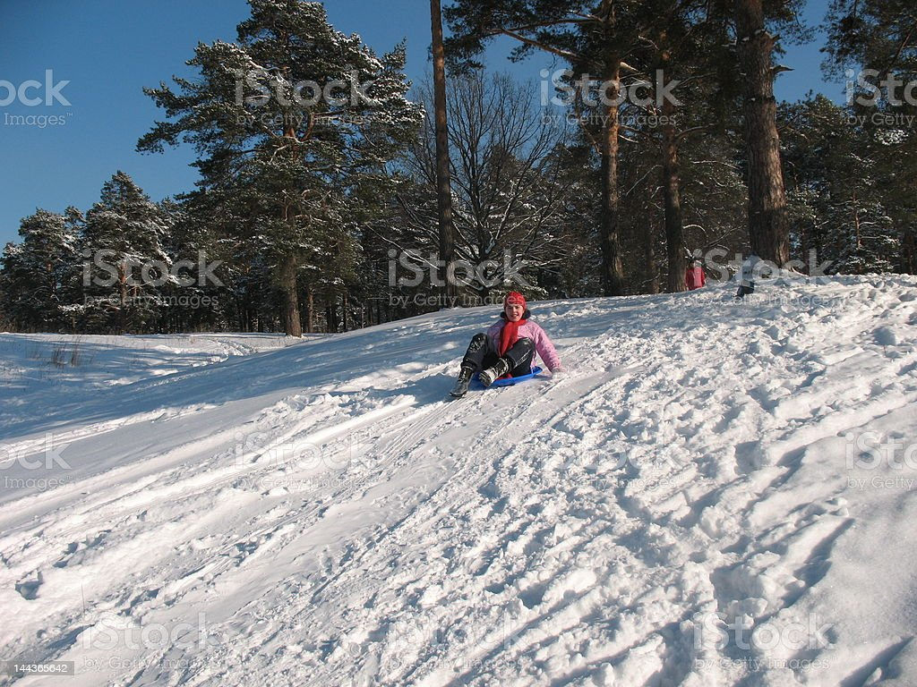Young girl on ice-hill stock photo