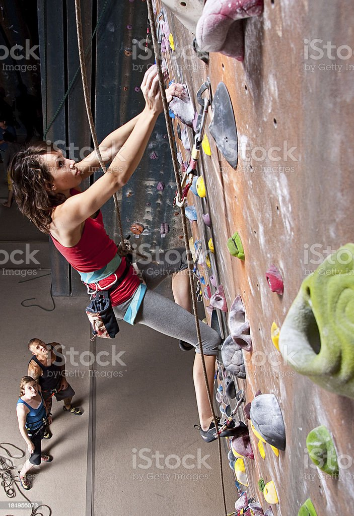 Young girl on interior climbing wall stock photo