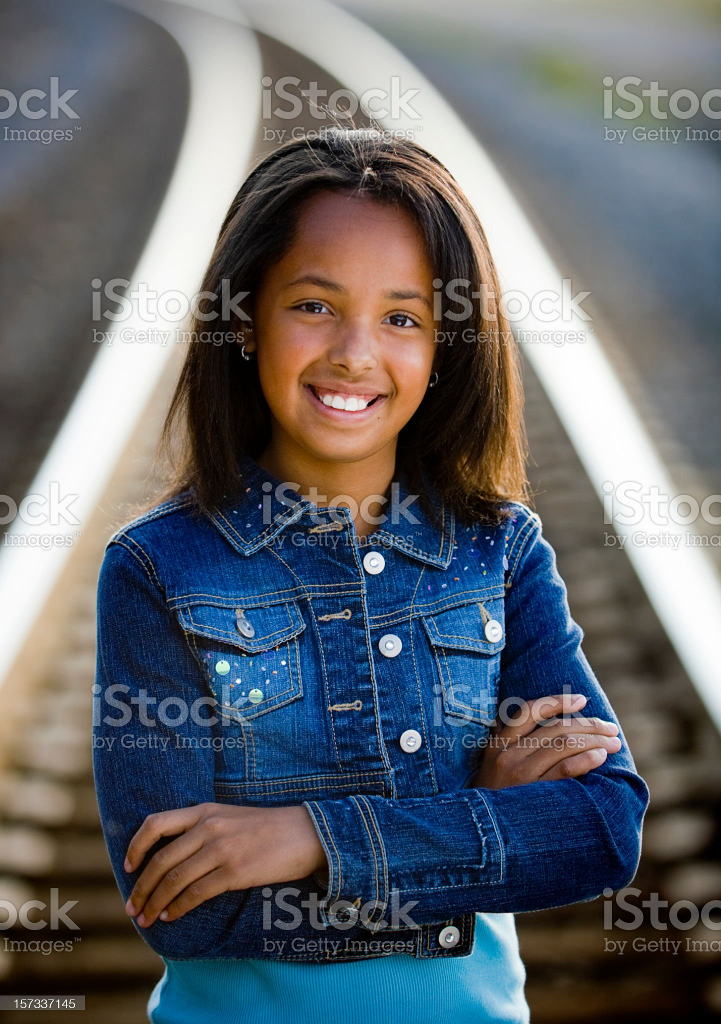 Young Girl on Railroad Tracks royalty-free stock photo
