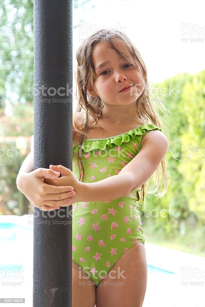 Young girl on swimsuit making face stock photo