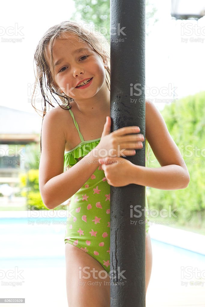 Young girl on swimsuit smiling to the camera stock photo