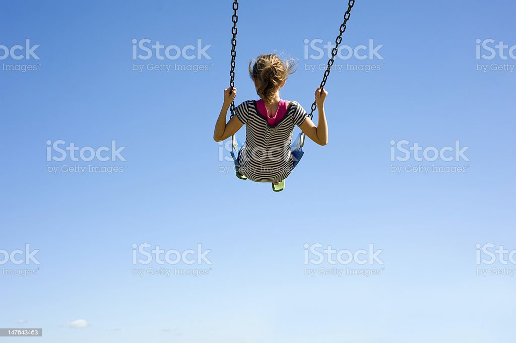 Young Girl on Swing stock photo